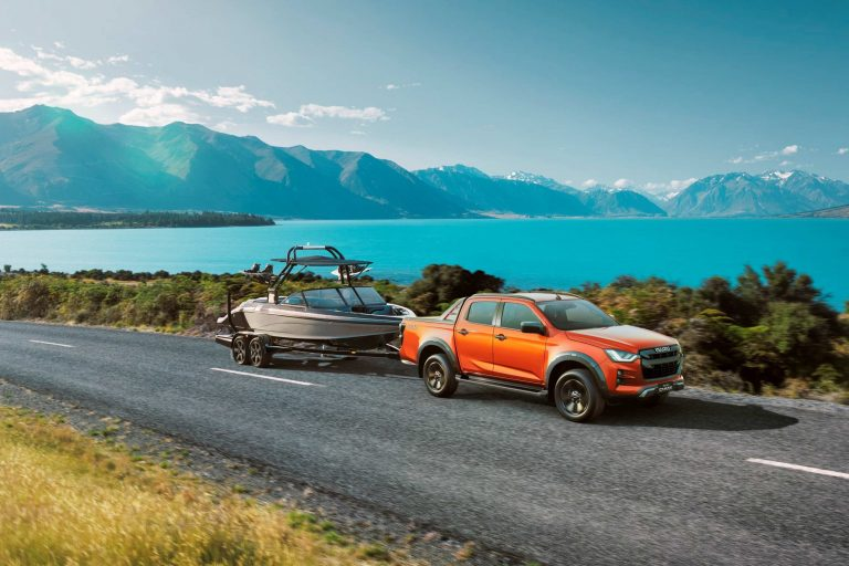 Isuzu-D-MAX-21MY-Towing-the-Line-with-Boat-4x4-X-TERRAIN-Volcanic-Amber-scaled.jpg